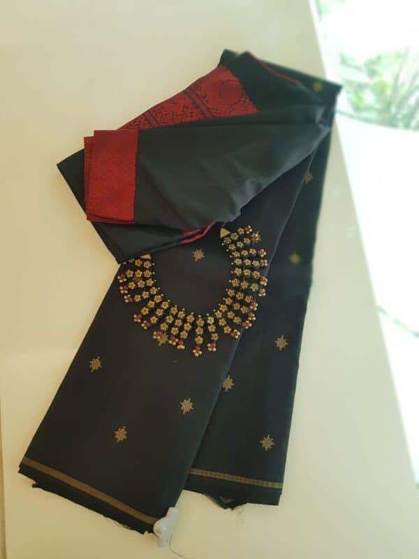 Black kanchipuram silk saree with zari buttis