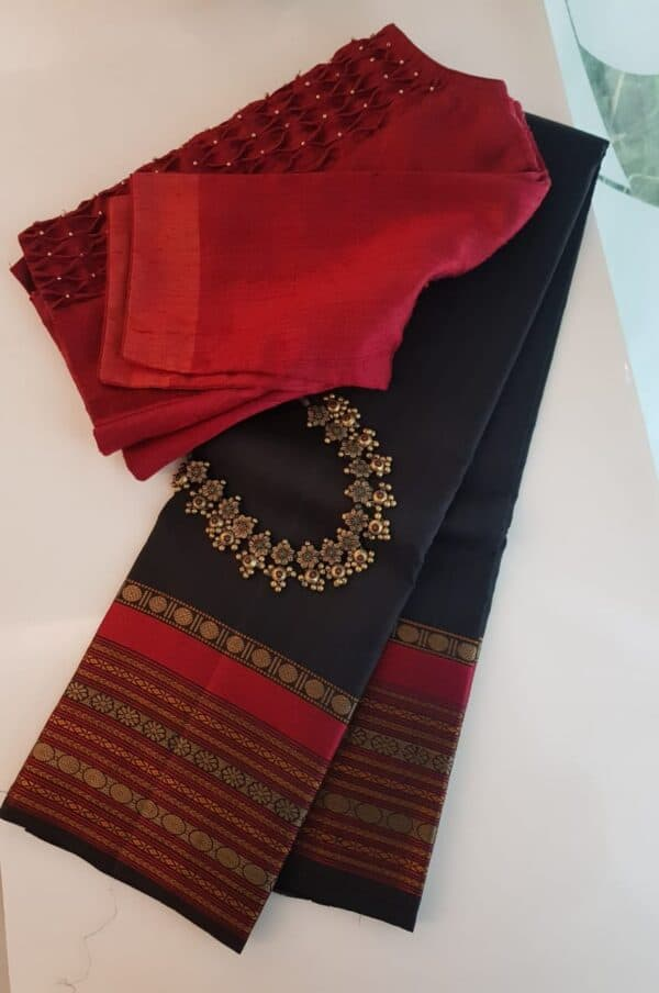 Black soft silk saree with red borderBlack soft silk saree with red border