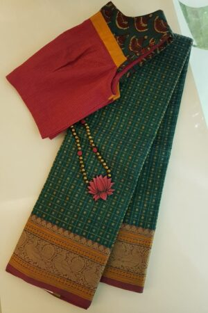 Green kanchi cotton saree with peacock border