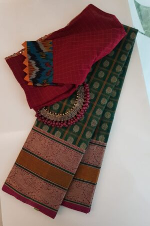 Green kanchi cotton saree with pink selvedge