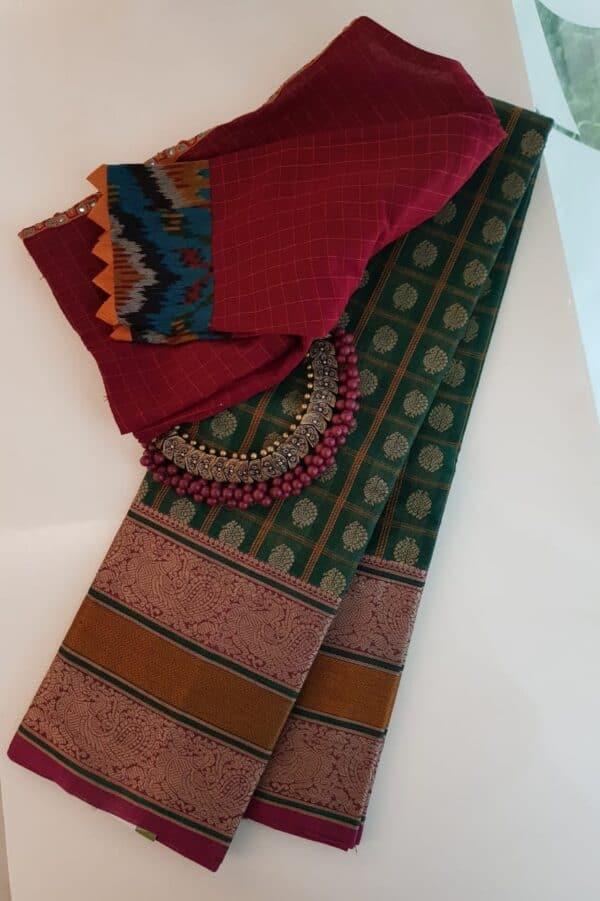 Green kanchi cotton saree with pink selvedge