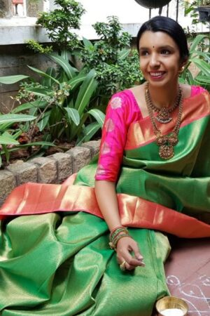 Green kanchipuram silk saree with pink border