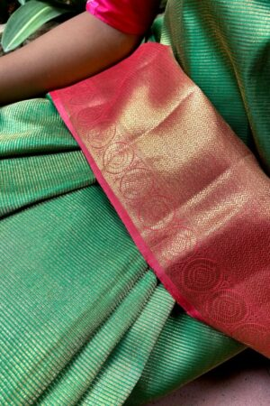 Green kanchipuram silk saree with pink border1