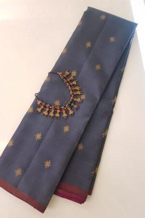 Grey kanchipuram silk saree with zari buttis