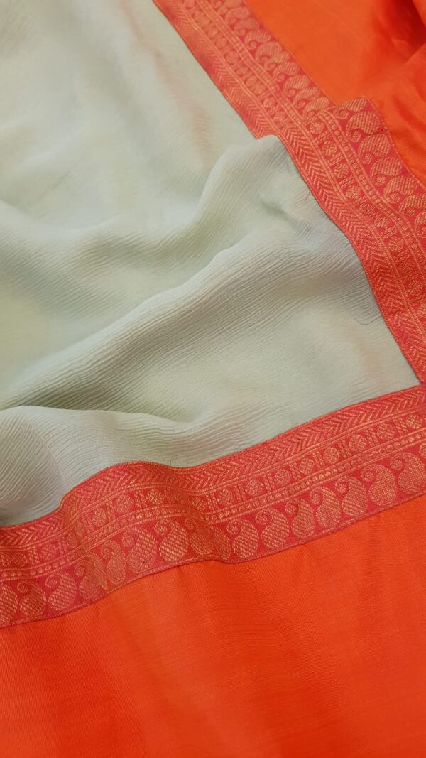 Pale green chiffon saree with orange silk border1
