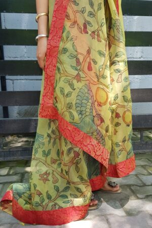 Pale green organza kalamkari dupatta with red kanchi border