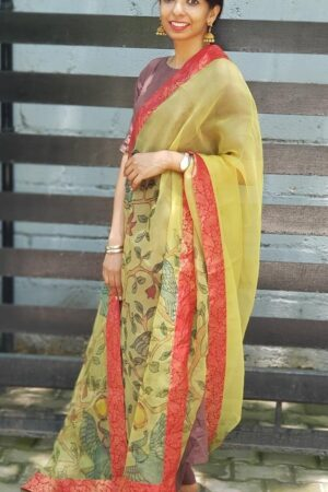 Pale green organza kalamkari dupatta with red kanchi border1