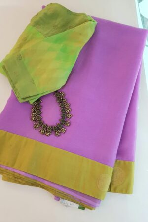 Purple chiffon saree with green silk border