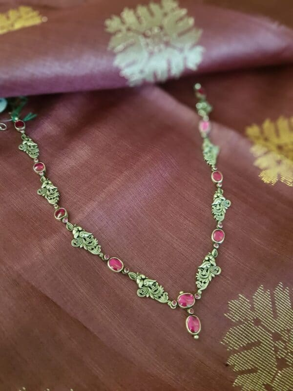 Silver chain with pink stones