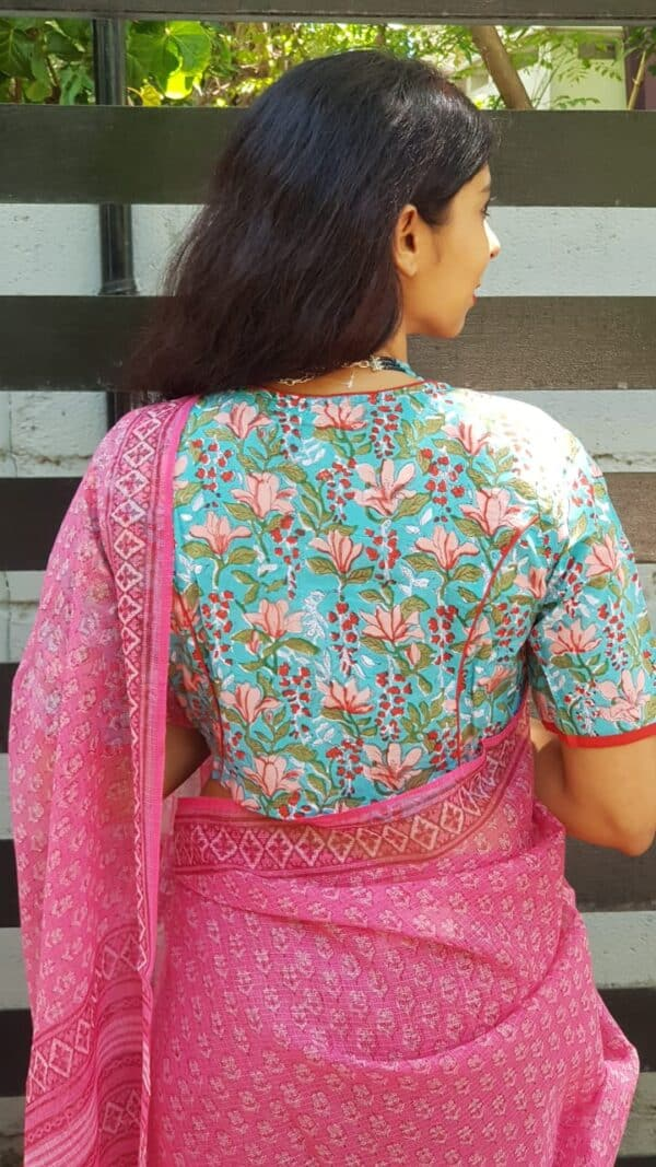 Teal green blouse with florals
