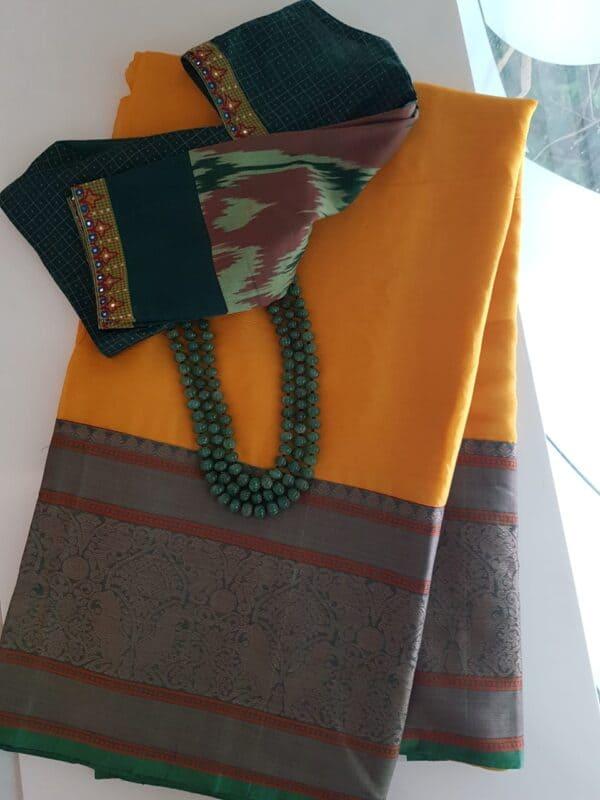Yellow chiffon saree with long kanchi cotton border