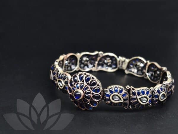 silver bangle with blue stones