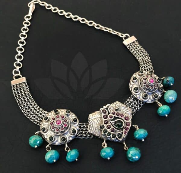 silver necklace with pendants and turquoise balls