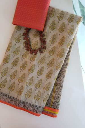 Beige and mustard block printed kota saree with silk border