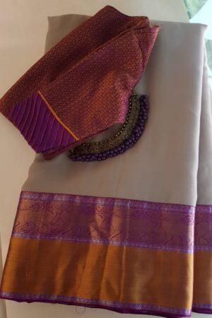 Beige with meenakshi violet silk border