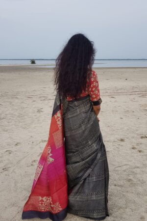 Black tussar saree with discharge prints and pink pallu