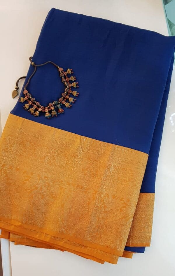 Blue chiffon saree with orange silk border