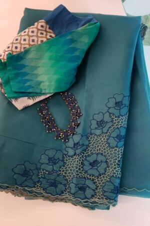 Blue organza cutwork saree
