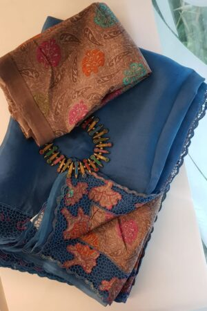 Blue organza saree with tussar pallu and cutwork border