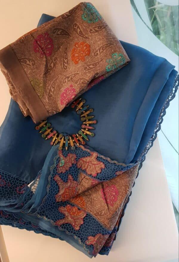 Blue organza saree with tussar pallu and cutwork border