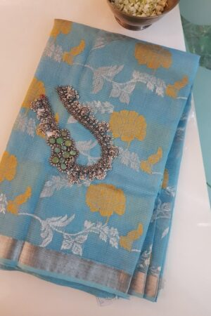 Blue zari kota saree with mustard flowers