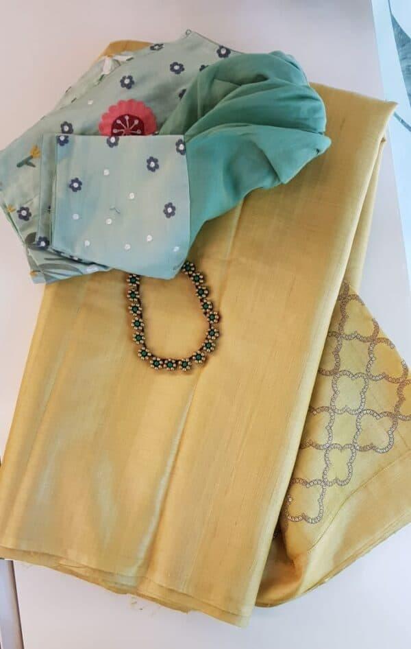 Butter yellow tussar saree with embroidered pallu