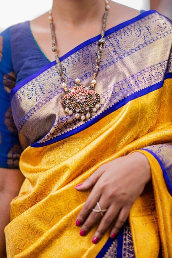 Mustard and blue kanchipuram silk saree