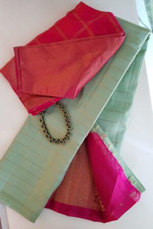 Green kanchipuram silk saree with pink pallu