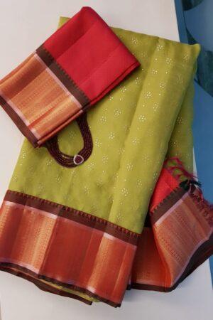 Green organza saree with kanchipuram silk border