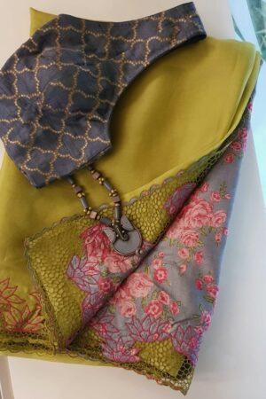 Green organza saree withvgrey tussar pallu and cutwork border