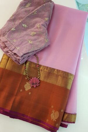 Light pink chiffon saree with rust border