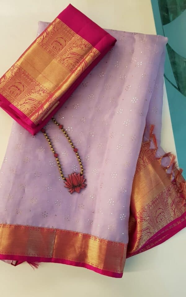 Pale lilac organza with pink Pale lilac organza with pink kanchipuram borderkanchipuram border