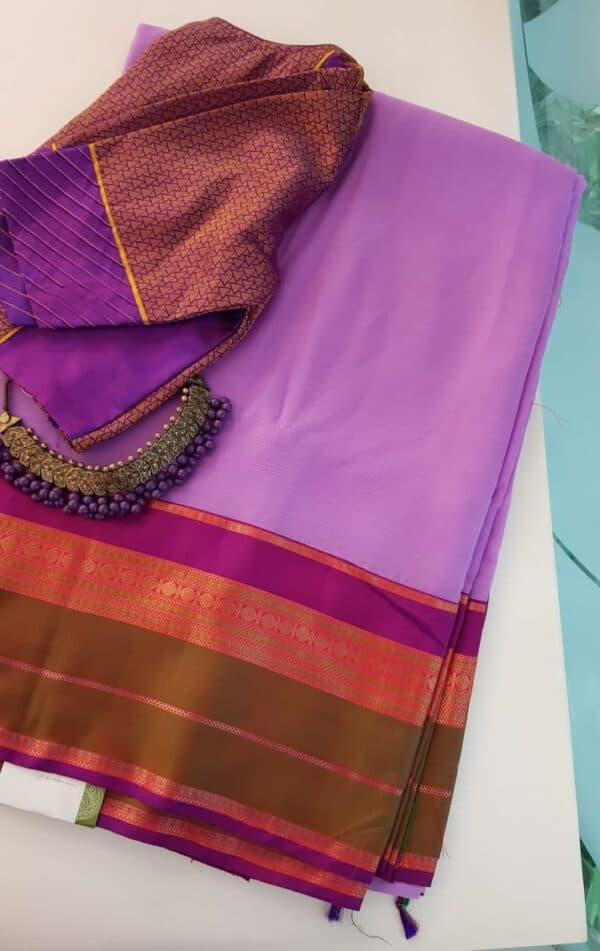 Purple chiffon saree with multi colour silk border