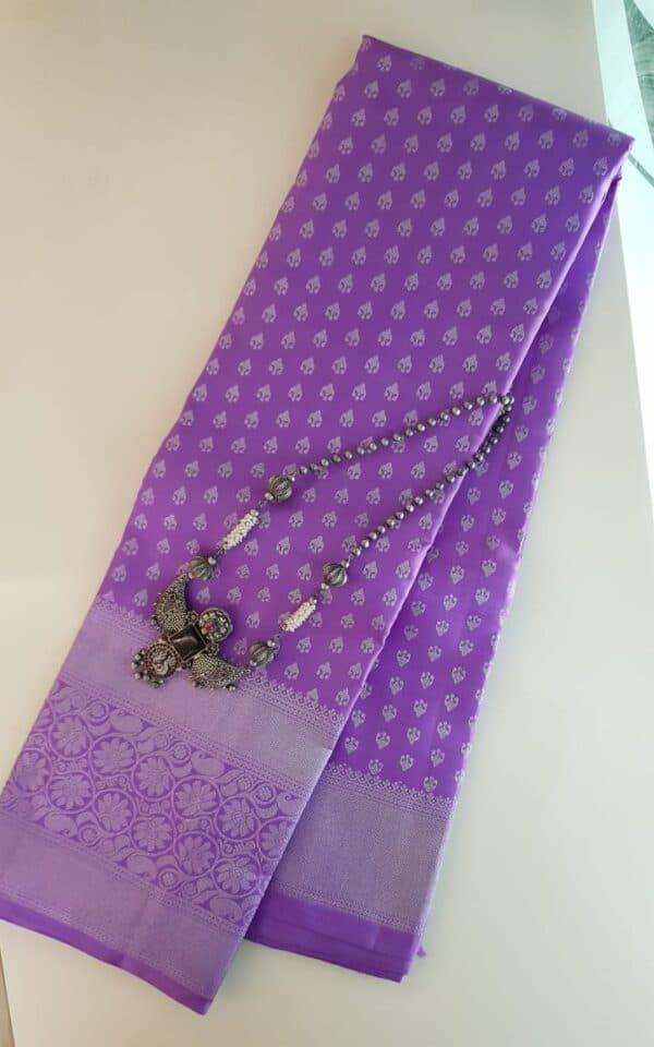 Purple kanchipuram silk saree with silver zari