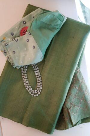 Sage green tussar saree with embroidered pallu