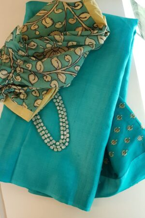 Turquoise blue tussar saree with embroidered pallu