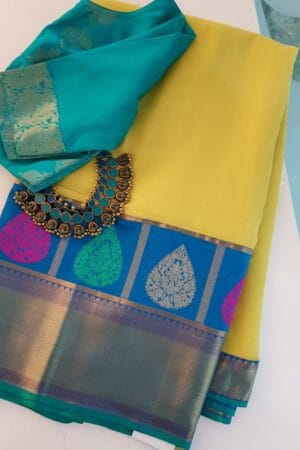 yellow chiffon saree with blue silk border