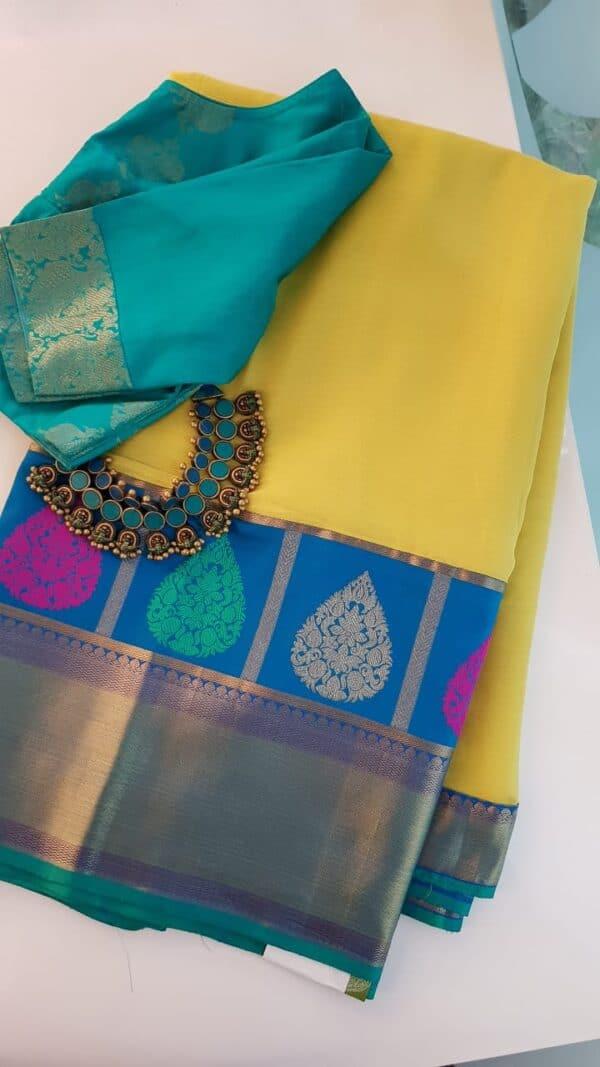 yellow chiffon saree with blue silk border