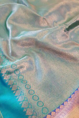 yellow chiffon saree with blue silk border1