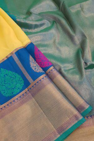 yellow chiffon saree with blue silk border2