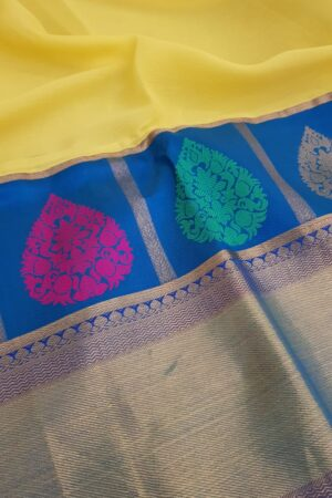 yellow chiffon saree with blue silk border3