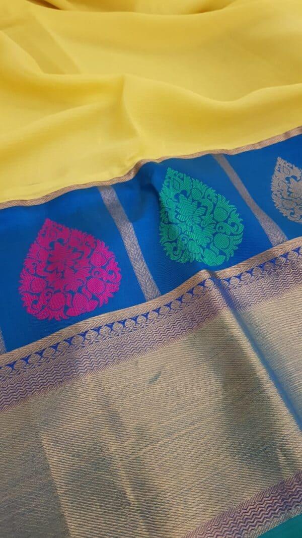 yellow chiffon saree with blue silk border3