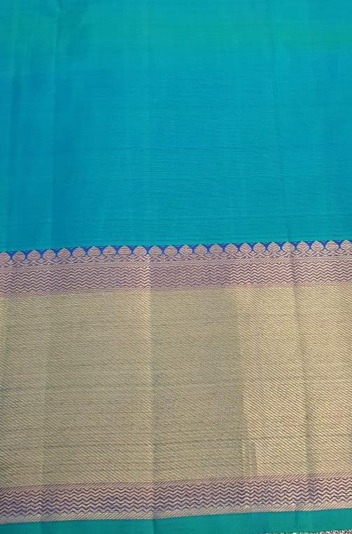 yellow chiffon saree with blue silk border4