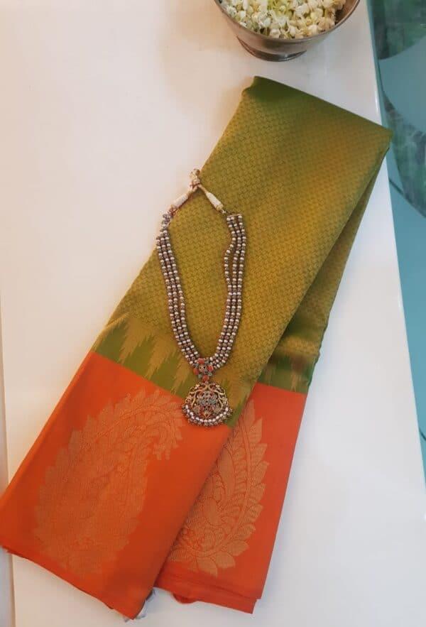 Olive green with orange mango border silk saree