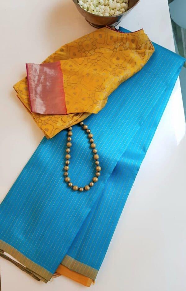 ananda blue kanchi silk saree with mustard pallu