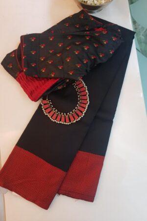 black kanchipuram silk saree with checked korvai border