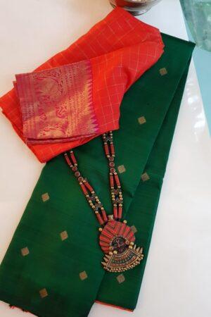 bottle green and orange half and half kanchi silk saree