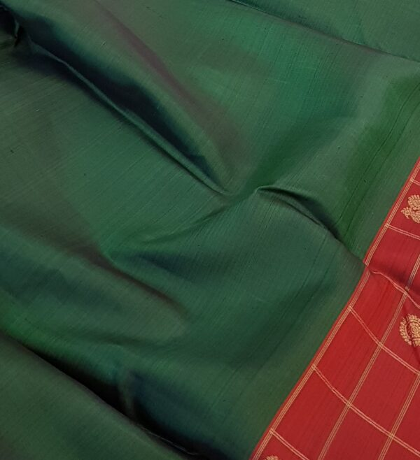 bottle green with one side border kanchi silk saree.3