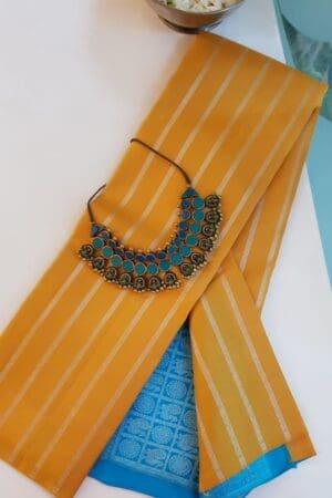 mustard kanchi silk saree with blue pallu