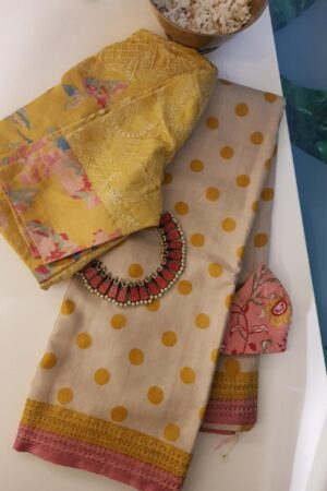 Beige tussar saree with polka dots and kutch work border